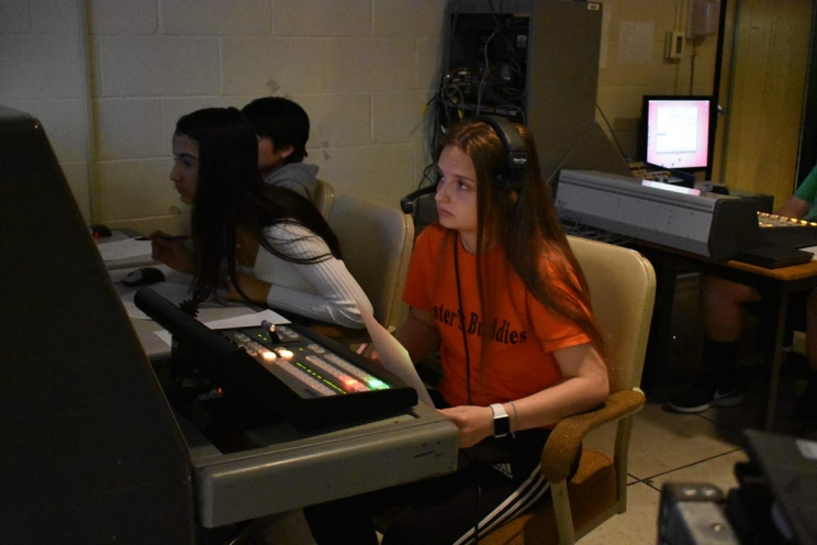 Master Control Operator, Graphics Manager, and Video Playback Manager Prepare for Morning News