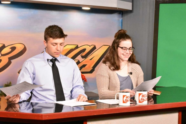 Reporters Prepare for the Morning Broadcast